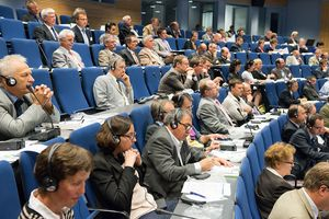 Conference delegates listening to a presentation in the plenary hall