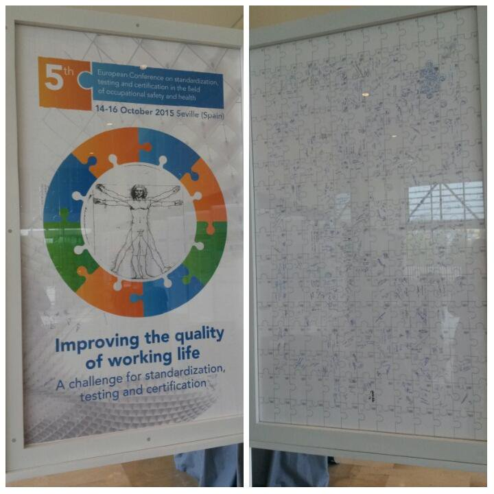 Big vertical jigsaw puzzle showing the conference logo on the front and participants' signatures on the rear